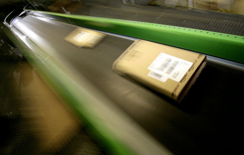 Parcels move along a conveyor belt in the Amazon.co.uk warehouse in  Milton Keynes, north of London